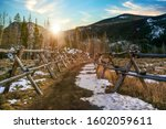 A Snow Covered Trailhead In...