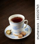 Tea Cup And Brown Sugar Cubes...