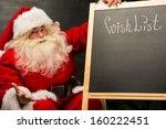 Santa Claus Sitting Near...