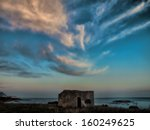 dramatic clouds in the strait of gibraltar, during sunset twilight - stock photo