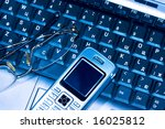 mobile phone and glasses on...   Shutterstock . vector #16025812