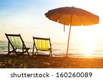 beach loungers on deserted... | Shutterstock . vector #160260089