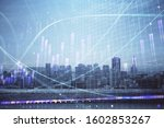 forex graph on city view with... | Shutterstock . vector #1602853267