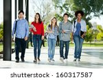 Stock photo full length portrait of confident students walking in a row on college campus 160317587