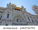 Close up on Cybele Palace (Centrocentro building) with Spain flag, in Madrid, capital city of Spain