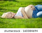 happy pregnant woman in the... | Shutterstock . vector #160384694