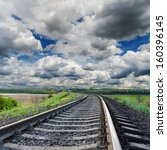 dramatic sky and railroad to horizon - stock photo