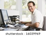 man in home office at computer... | Shutterstock . vector #16039969
