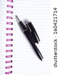ballpoint pen and notebook  | Shutterstock . vector #160421714