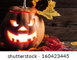 jack o lantern with leaves on...   Shutterstock . vector #160423445