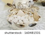 Composition of wedding dragee on the table in the wedding day - stock photo