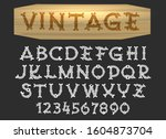 vintage font in wood cut style. ... | Shutterstock . vector #1604873704