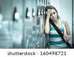 wincing pretty student having a ...   Shutterstock . vector #160498721
