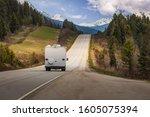 Tourists driving down the roads of the Canadian Rockies in an RV on a beautiful summer day - stock photo