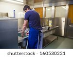 kitchen porter washing up at... | Shutterstock . vector #160530221