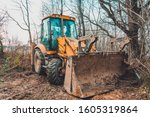 The Excavator Works In The...