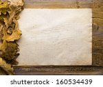 autumn leaves and old paper on