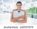 cheerful toned brunette holding ... | Shutterstock . vector #160537079