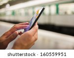 woman using her cell phone on... | Shutterstock . vector #160559951