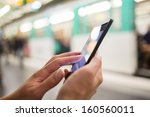 woman using her cell phone on... | Shutterstock . vector #160560011