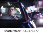 businessman driving at night in ... | Shutterstock . vector #160578677