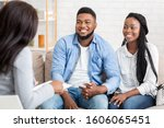 Small photo of Together Again. Portrait Of Happy African American Couple Holding Hands After Reconciliation On Marital Therapy Session At Psychologist's Office.