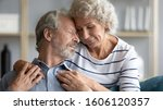 Small photo of Hoary wife hugs from behind snuggle to beloved husband 60s loving couple closed eyes enjoy tender moment, showing care, promising to love each other until the end of life in sorrow and in joy concept