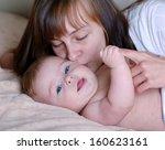portrait of mother kissing her... | Shutterstock . vector #160623161