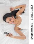 natural smiling woman using her ...   Shutterstock . vector #160632365