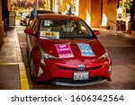 Small photo of Sacramento, CA—Aug 28, 2019; Gig economy driver's car with Uber and Lyft tags with pro union signs to protest in support of California Assembly Bill AB5 that would give unionization rights