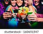 glasses with cocktails held by... | Shutterstock . vector #160651547