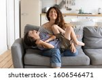 Cheerful Mother Sitting On...