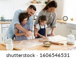 Small photo of Full family feels happy cooking together gathered in domestic kitchen preparing family recipe pie or dessert, playful siblings helping to parents, mom and dad teaching kids, hobby and pastime concept
