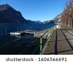 Sunny lakeside promenade of the Italian lakeside town Lecco at the famous Lake Como