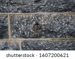 A church stone fence with a loop to attach the horse