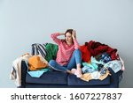 sad woman with heap of clothes... | Shutterstock . vector #1607227837