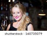 beautiful blond woman enjoying... | Shutterstock . vector #160735079