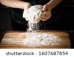 Small photo of The process of making pizza dough, female hands knead flour