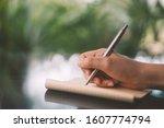 Woman Hand Using Pen Writing O...