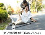 Small photo of Tired senior woman or mother suffer from sunburn very hot,feel faint,dizzy,daughter assisting,support her in outdoor at park,female elderly with syncope,unconscious or heat stroke,sun stroke,fatigue