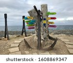 An Anchor And Tree Stump With...