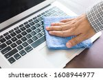 Male Hand Cleaning Laptop With...