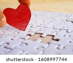 Hand Holding A Red Heart On A...