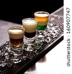 three layered shots on a bar... | Shutterstock . vector #160907747
