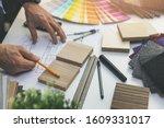 Designer choosing flooring and...