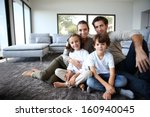happy family portrait at home... | Shutterstock . vector #160940045