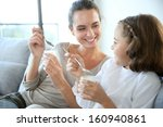 mother and daughter eating... | Shutterstock . vector #160940861