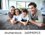 family at home relaxing on... | Shutterstock . vector #160940915