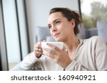 peaceful woman relaxing at home ... | Shutterstock . vector #160940921