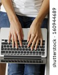 Woman's Hands Typing On A...